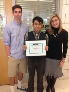 Barbara and Robert Morelli award first annual scholarship to Mr. Tran of East High School.